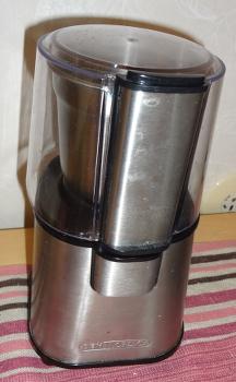 [Bild: Kaffekvarnstoppen med tättslutande lock på sin förvaringsplats]